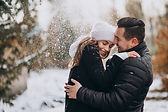 young-couple-winter-snow-falling-from-tr