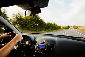 man-driving-car-road_23-2148322019.jpg
