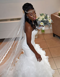 Beautiful Afro Caribbean Bride with Bridal Updo and Makeup by Asia Wray