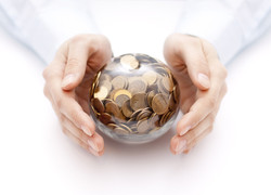 Crystal ball with money in hands.jpg
