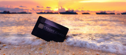 Credit card on the tropical beach in Pattaya at sunset,travel and holiday concept._edited.jpg