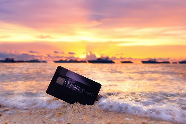 Credit card on the tropical beach in Pat