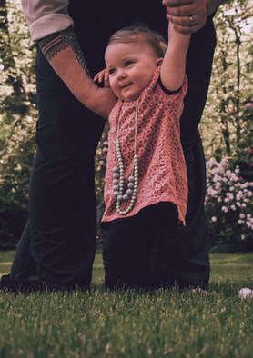 Toddler practicing standing