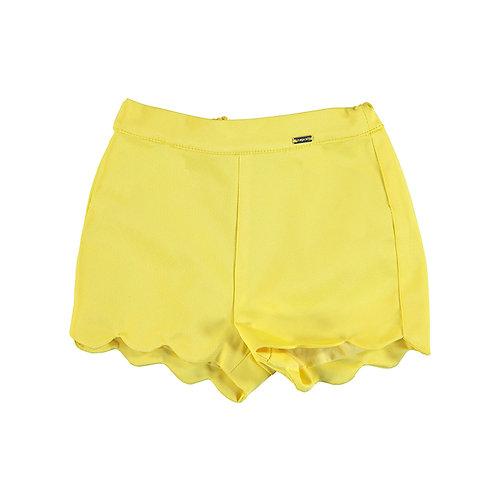 Short jaune à volants
