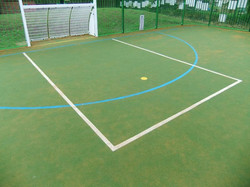 Artificial turf with in laid marking