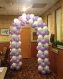 purple and white balloon arch.png