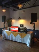 wedding DJ setup w_ TV and lights.jpg
