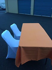 orange tablecloth w white chair covers.j