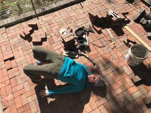 Yoga break while laying bricks