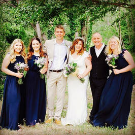 Bride, groom with bridesmaids and Celebrant