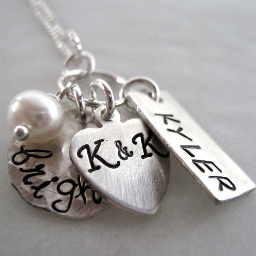Small Family silver stamped necklace