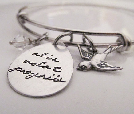 Alis volat propriis bracelet with bird
