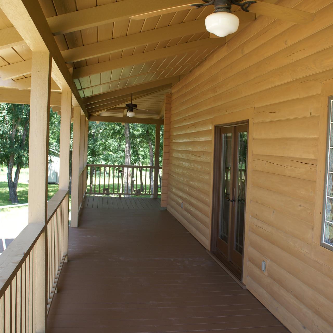cypress log home back porch