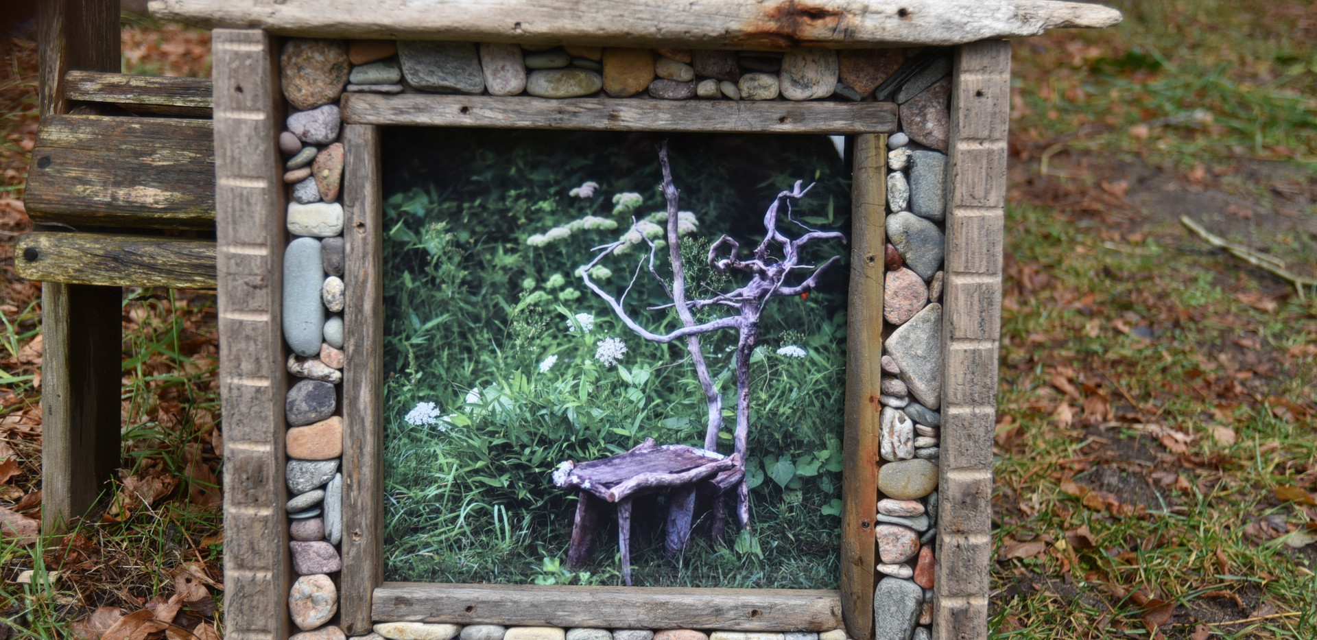 Mirror with drift wood and stones