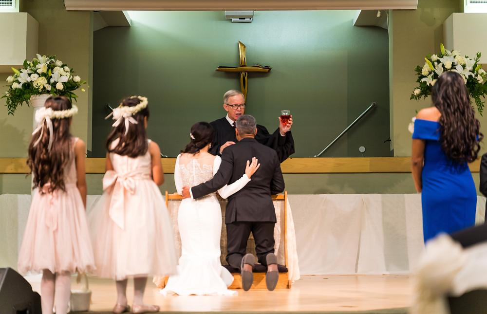 Enrique and Valeria Receiving Communion El Paso Wedding