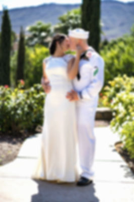 Bride and Groom Rose Garden Kiss