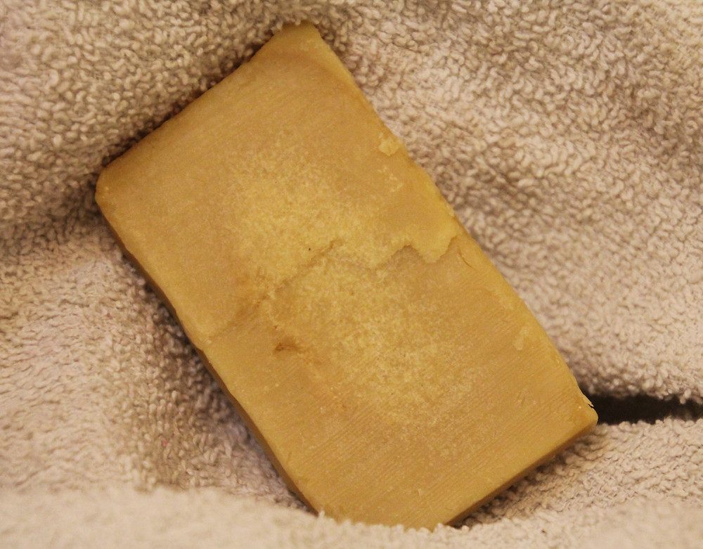 Photo of a bar of natural soap on a towel