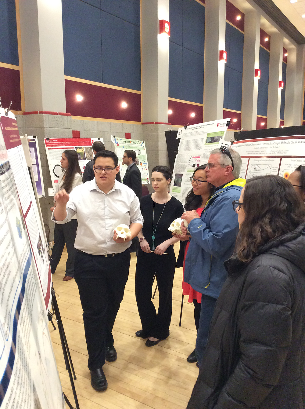 Jordan Guerra explains the project to Fred Grine (Anthropology Department chair).