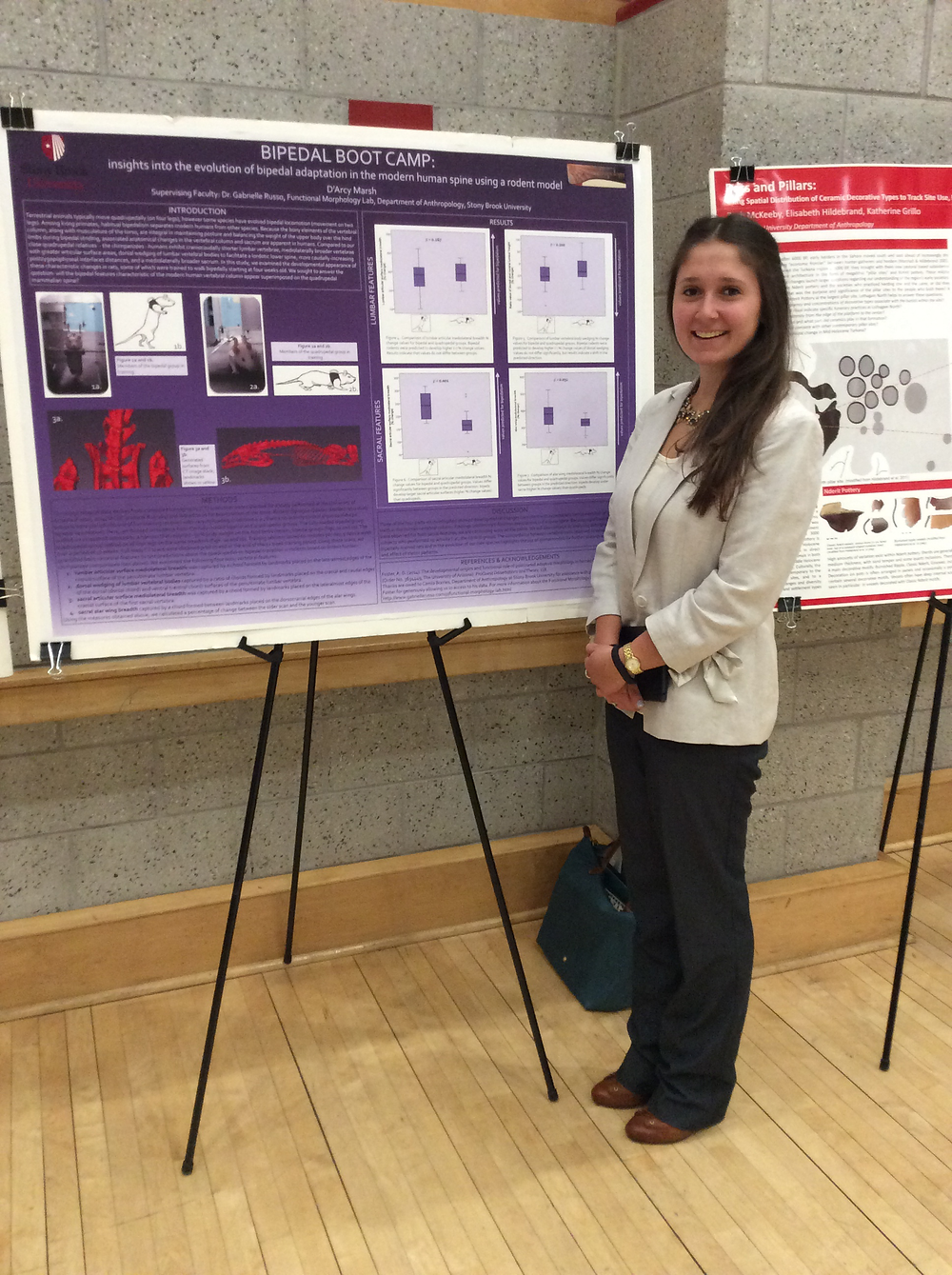"""D'Arcy Marsh (17', Anthropology major, Biology minor) presenting her poster """"Bipedal Bootcamp: insights into the evolution of bipedal adaptations in the modern human spine using a rodent model""""."""