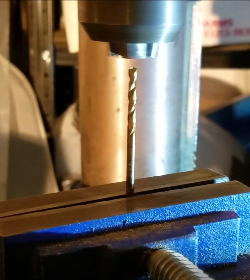 Using a drill press to center drill round stock