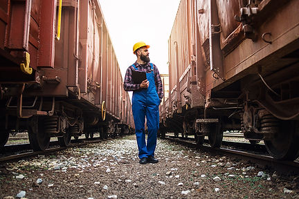 railway-transportation-supervisor-checking-trains-cargo.jpg