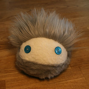 Brown plush therapy toy for kids and adults