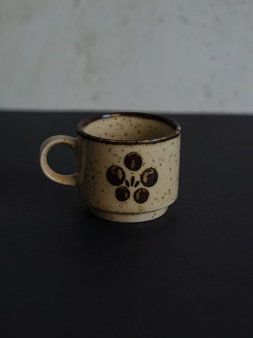 Brown ceramic coffee cup
