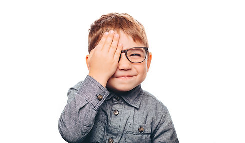 Portrait of little positive boy with eye