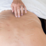 Palpating to locate an acupuncture point