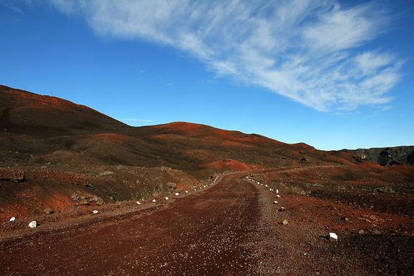 dirt-road-middle-deserted-hills-blue-sky