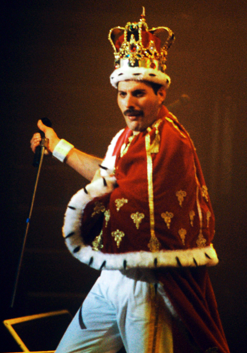 Freddie dressed as the actual Queen of England while onstage.