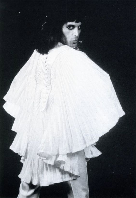 Freddie wearing a white tunic that features heavily in the Bohemian Rhapsody trailer.