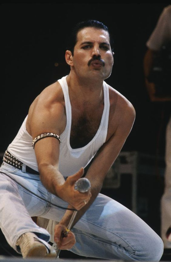 The second of Freddie's most iconic outfits: the white vest, blue jeans & studded armband/belt look that he wore at the 1985 Live Aid concert dubbed 'the best rock performance of all time'.