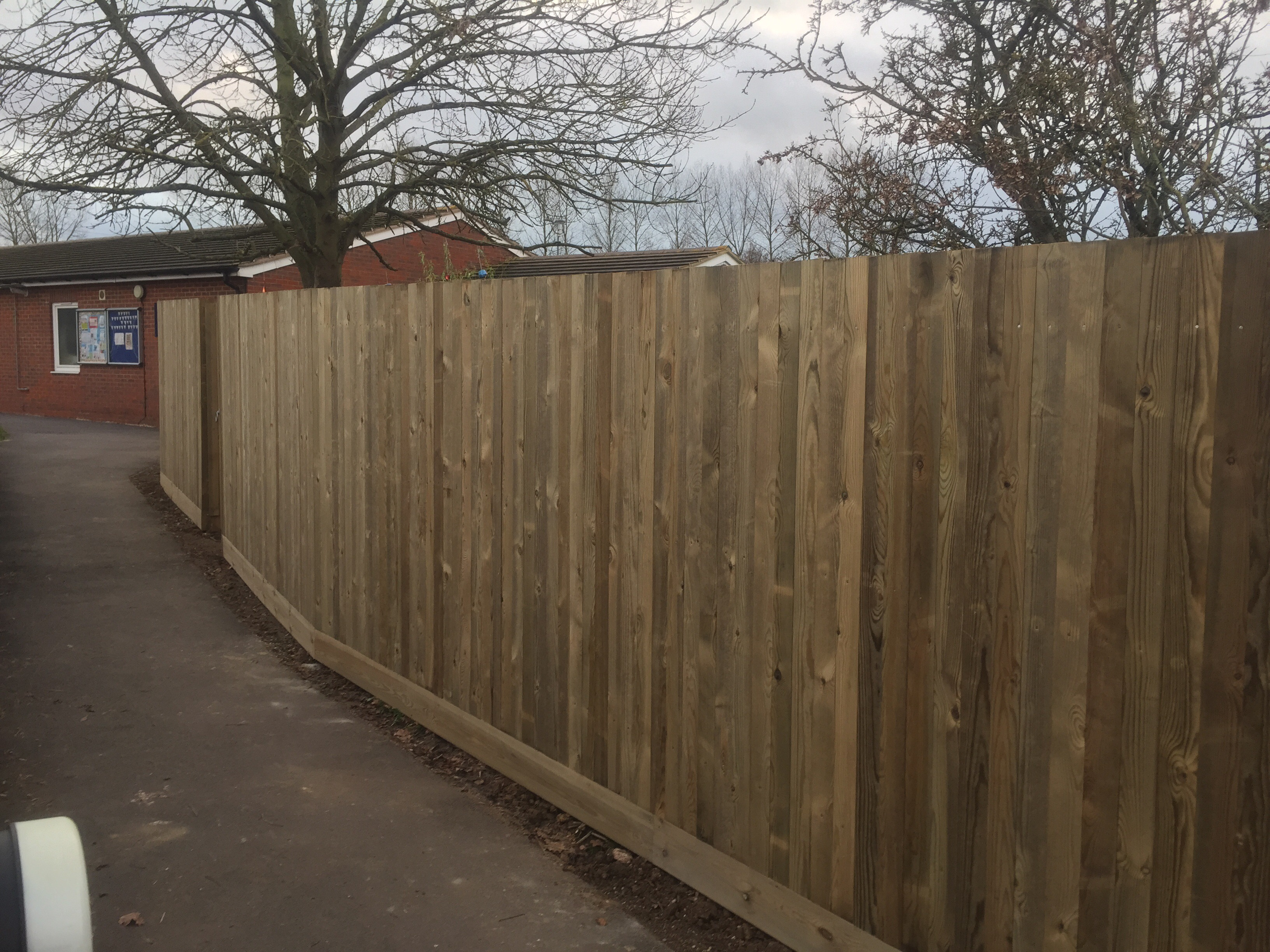 Planed wood fence
