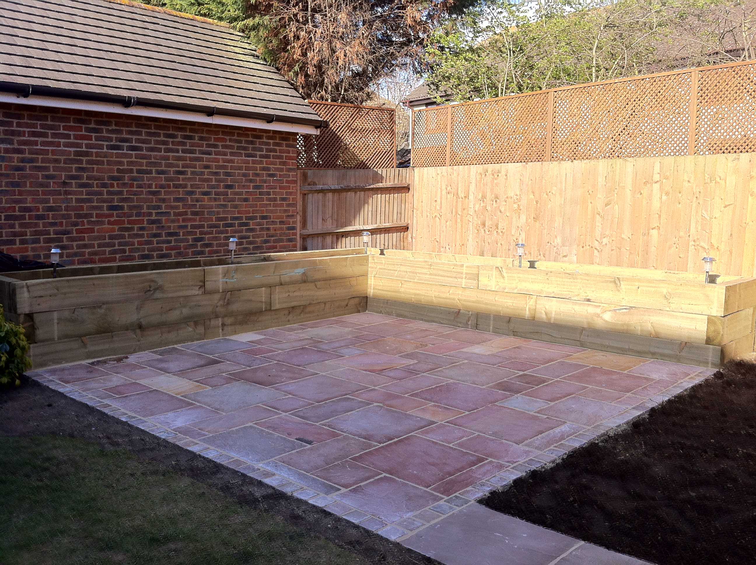 Raised sleeper bed, Sandstone patio