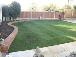Retaining wall, new lawn and patio