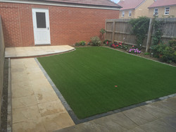 Concrete slabs and artificial lawn