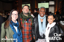 Esther Coleman-Hawkins standing with guests at an Our Match event