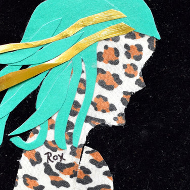 Leopard face, green and gold hair, blac velveteen background, mixed media.