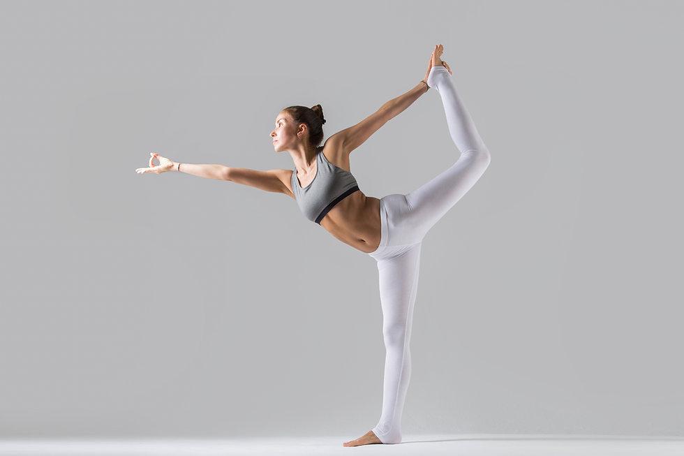 young-woman-natarajasana-pose-grey-studi