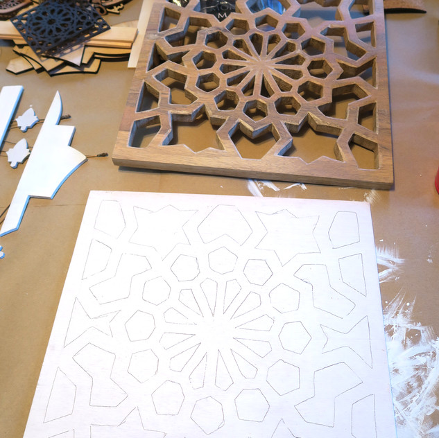 Pattern traced onto the backing panel as a guide for creating the individual collages.