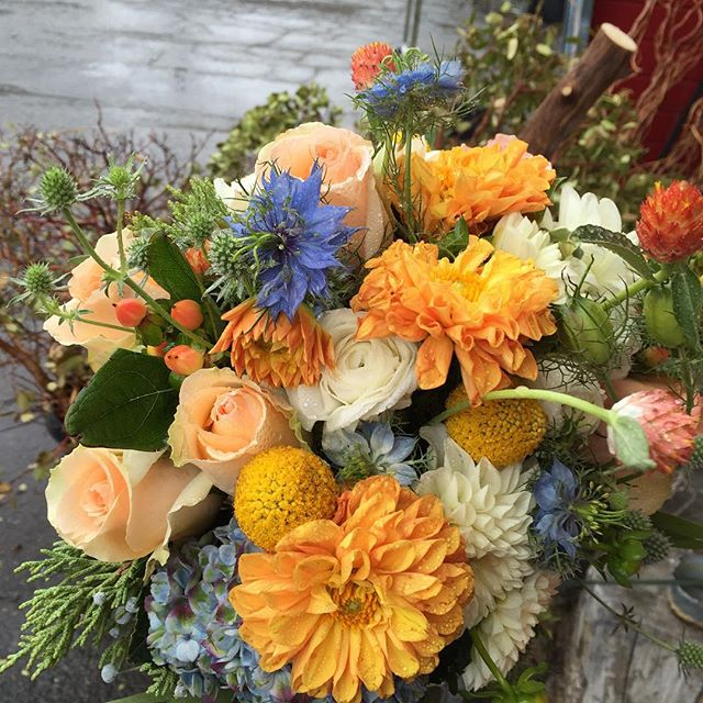 Rainy day wedding = good luck! #convictlakeresort #convictlake #bride #fallwedding #dahlias #mammoth