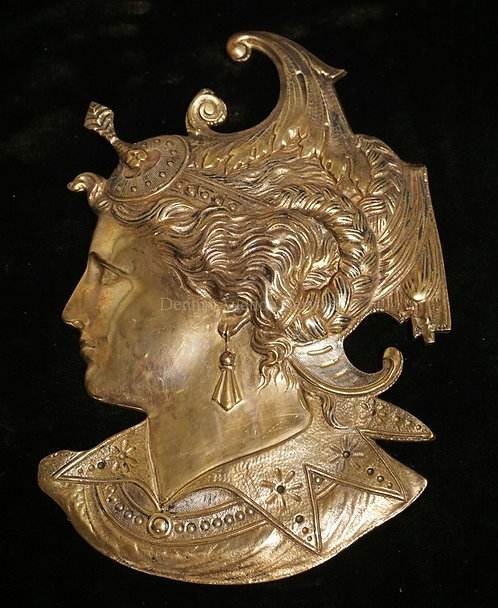 BRONZE PLAQUE IN THE FORM OF THE BUST OF A WOMAN. CAME FROM A FIREPLACE MAINSTON