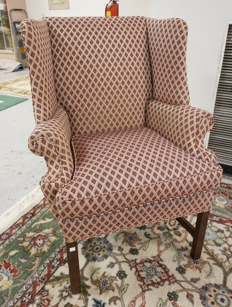 UPHOLSTERED WING CHAIR. 40 1/2 INCHES HIGH. 30 1/2 INCHES WIDE.