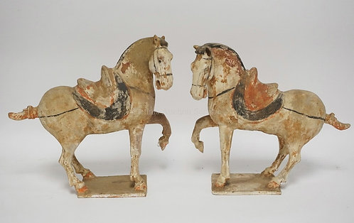 PAIR OF ASIAN TERRA COTTA HORSES MEASURING 12 3/8 INCHES HIGH. CORNER CHIP ON ON