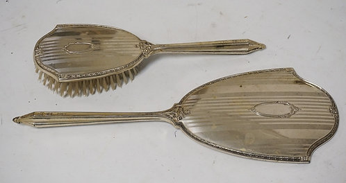 MATCHING STERLING SILVER BRUSH & MIRROR. THE MIRROR MEASURES 13 3/4 INCHES LONG.