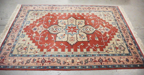 WOOL ORIENTAL RUG MEASURING 9 FT 4 X 6 FT 1 INCHES.