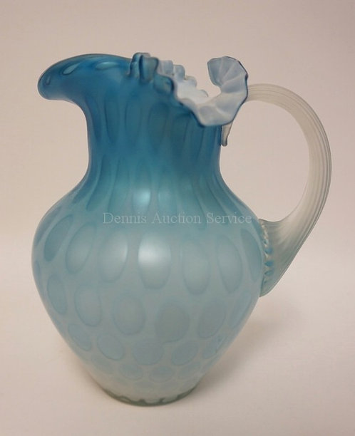 SATIN GLASS PITCHER IN BLUE WITH A COINSPOT PATTERN, APPLED RIBBED HANDLE, AND A