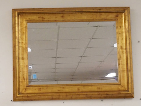 WALL MIRROR HAVING BEVELED EDGES AND A GOLD GILT FRAME MEASURING 28 3/4 X 37 INC