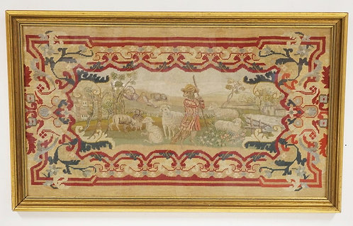 FRAMED ANTIQUE NEEDLEWORK OF LAMBS WITH A SHEEP DRESSED AND A SHEPHERD WHILE THE